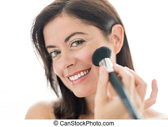attractive woman in her forties applying makeup - Beautiful...