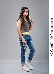 Attractive woman in jeans with brunette hair