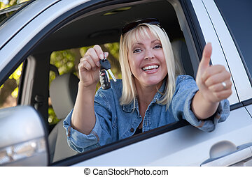 Attractive Woman In New Car with Keys - Attractive Happy...