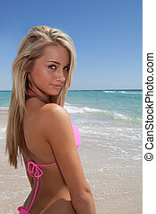 Attractive woman in pink bikini on - Attractive young woman...