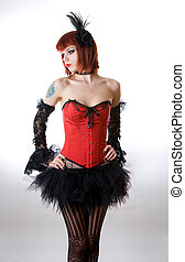 Attractive woman in red corset and black skirt