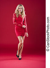 Attractive woman in red lace dress