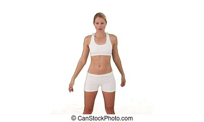 Attractive woman in sportswear doing exercise