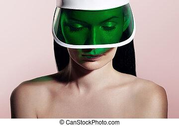 attractive woman in sun visor - woman in a sun visor on a ...
