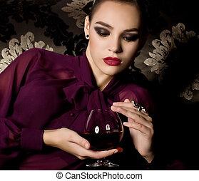 Attractive woman in the wine cellar