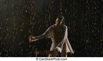 Attractive woman in wet beige leotard is dancing ballet in ...