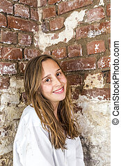 woman in white shirt with old brick wall background