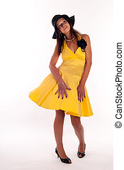 Attractive woman in yellow dress and hat