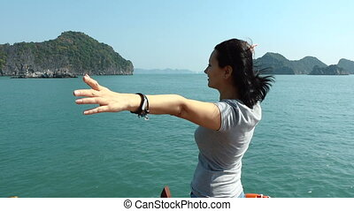 Attractive woman is standing with arms outstretched
