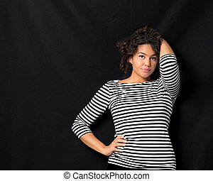 Attractive Woman Leaning Against Wall