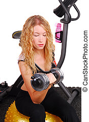 Attractive woman lifting dumb bell - Young attractive...