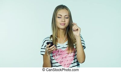 Attractive woman listening to music on headphones