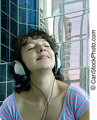 listening to music - Attractive woman listening to music