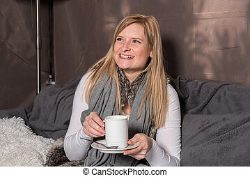 Attractive woman looking forward to her hot drink from the cup