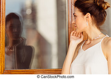 Attractive woman looking her reflection