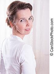attractive woman looking over shoulder