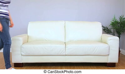 Attractive woman lying on her couch