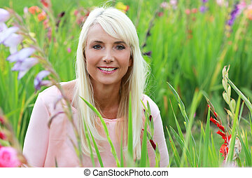 Attractive woman middle age in nature