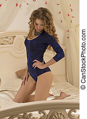 Attractive woman on a bed