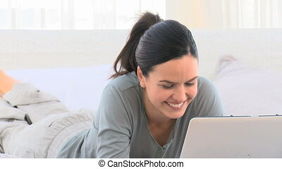 Attractive woman on her laptop