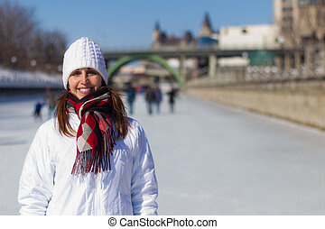 Attractive woman on the Ottawa Rideau Canal Skateway during wint