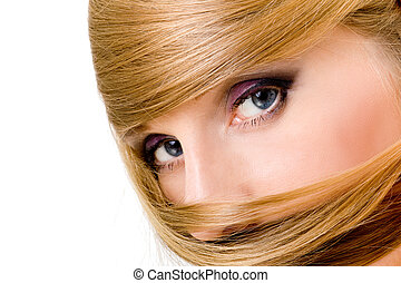Beautiful blye eyes of woman with long blond hair around, watching in camera, isolated over white