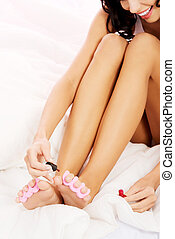 Attractive woman painting her toes. - Attractive woman...