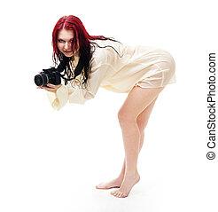 Attractive woman photographer posing