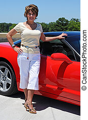 Attractive Woman with her Red Sports Car