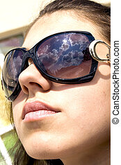 Attractive woman in sun glasses