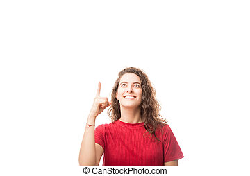 Attractive woman pointing at copy space