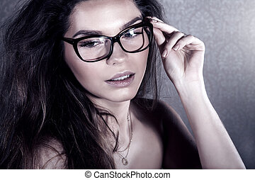 Attractive woman posing in eyeglasses - Portrait of...