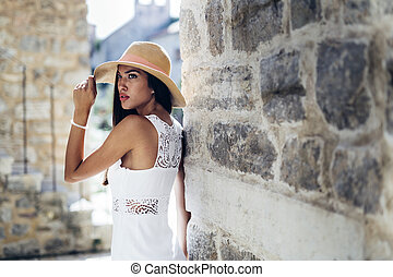 Attractive woman posing in hat