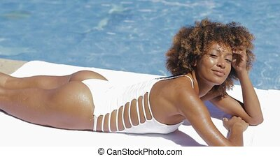 Attractive woman posing in pool - Pretty content model in...