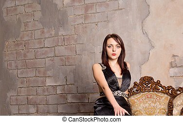 Attractive woman posing on a grunge wall