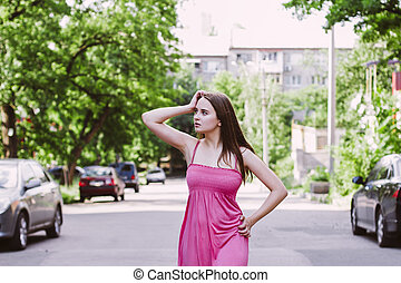 Attractive woman posing on the street