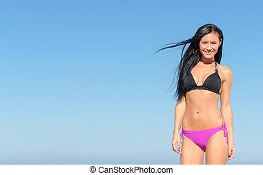 Attractive woman posing over blue sky. Place for text.