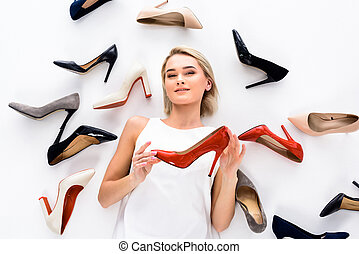 attractive woman posing with heeled shoes, isolated on white