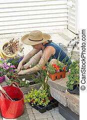 Attractive woman potting up nursery seedlings