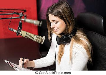 Attractive woman radio host