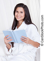 Attractive woman reading a book