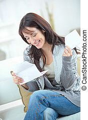 attractive woman reading a letter