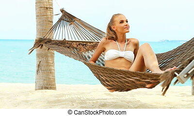 Attractive woman relaxing in a hamm - Beautiful woman full...