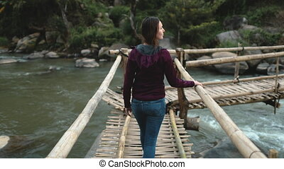 Attractive woman, river bridge, Thai rainforest. Girl ...