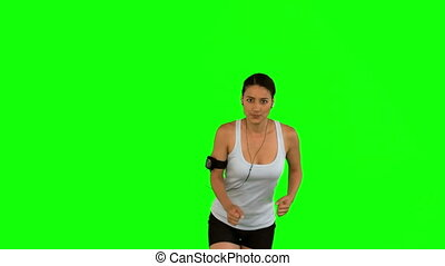 Attractive woman running toward camera