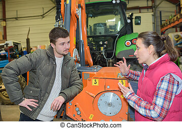 attractive woman selling brand new tractor to beginner farmer