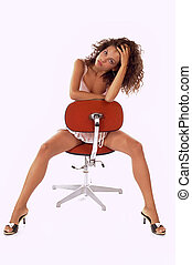 Attractive woman - Sexy young woman sitting on chair
