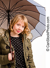 Attractive woman sheltering under an umbrella