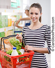Attractive woman shopping at store - Attractive young woman...