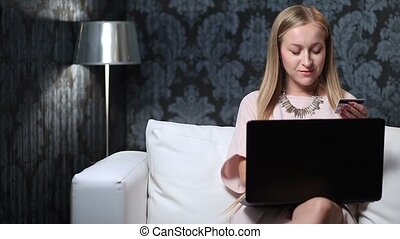 Attractive woman shopping online using laptop